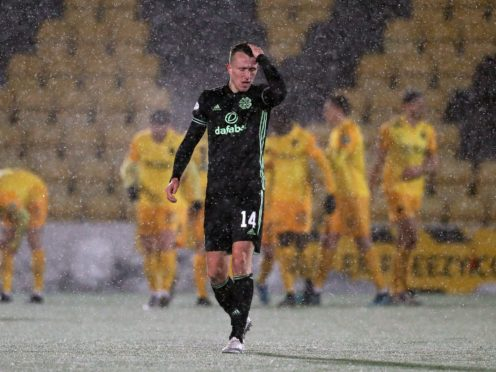 Celtic's David Turnbull is dejected as Livingston players celebrate during a meeting in January (Andrew Milligan/PA)