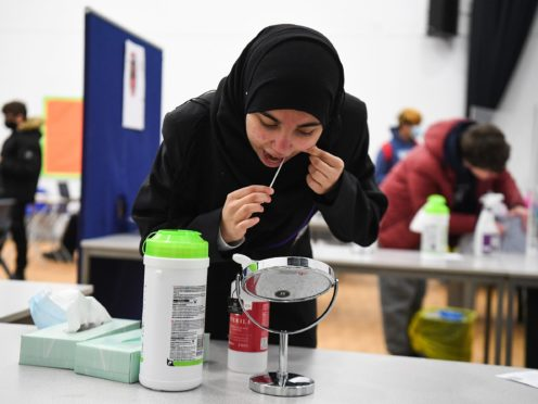 A student takes a Lateral Flow Test at Hounslow Kingsley Academy in West London (PA)