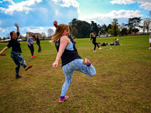 People take part in an outdoor AfroFusion dance exercise class on The Downs, Clifton, Bristol (PA)