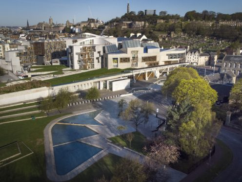 The Scottish Parliament building at Holyrood could be designated a protected site, making it a criminal offence to remain without lawful approval (Jane BArlow/PA)