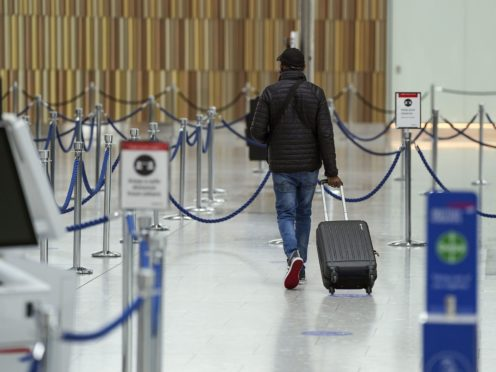 Fully vaccinated travellers no longer need to take a pre-departure test (Steve Parsons/PA)