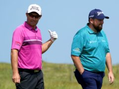 Shane Lowry (right) could leave friend and Ryder Cup captain Padraig Harrington with a tough decision on Sunday (Gareth Fuller/PA)