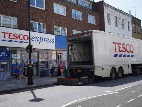 A delivery lorry outside a Tesco Express store in central London. The supermarket has told Government officials that it has fears of potential panic buying before Christmas (Yui Mok/PA)