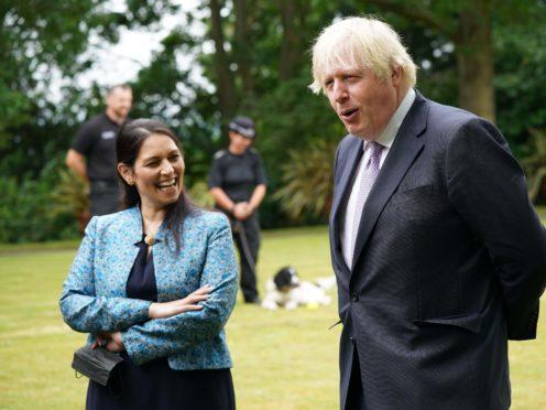 Prime Minister Boris Johnson and Home Secretary Priti Patel (Yui Mok/PA)