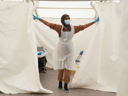 An NHS worker looks for patients at a Covid-19 pop-up vaccination centre in Langdon Park, Poplar, east London (Kirsty O'Connor/PA)