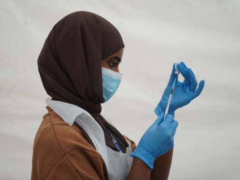 An NHS worker prepares a Covid-19 jab at a pop-up vaccination centre in Langdon Park, Poplar, east London (Kirsty O'Connor/PA)