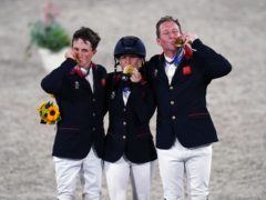 Tom McEwen (left) celebrates Olympic gold with Laura Collett and Oliver Townend (Adam Davy/PA)
