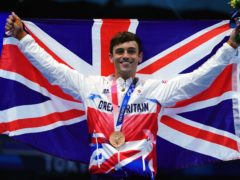 Tom Daley of Great Britain with a bronze medal following the Men's 10m Platform Final at the Tokyo Aquatics Centre on the fifteenth day of the Tokyo 2020 Olympic Games in Japan. Picture date: Saturday August 7, 2021.
