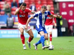 Charlie Wyke is off the mark for Wigan after netting a brace at the weekend (Tess Derry/PA)