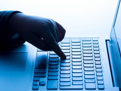 A child using a laptop computer (Dominic Lipinski/PA)