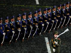 Soldiers of Belarus' military band perform during the Spasskaya Tower International Military Music Festival in Red Square in Moscow (Alexander Zemlianichenko/AP)