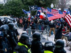 Insurrections loyal to President Donald Trump confront police officers outside the Capitol in Washington (AP Photo/Manuel Balce Ceneta, File)