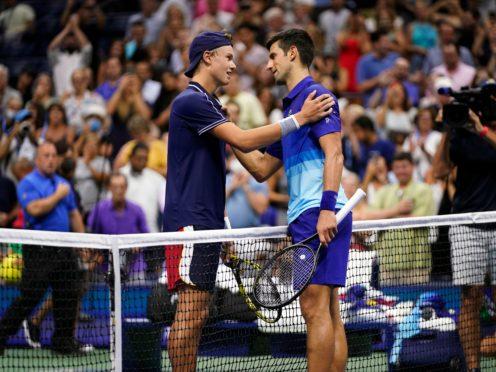 Novak Djokovic commiserates with Holger Rune (Frank Franklin II/AP)
