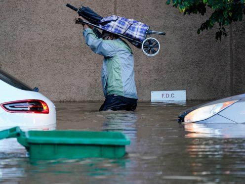 A person walks in floodwaters in Philadelphia (AP Photo/Matt Rourke)
