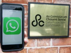 An iPhone displaying a WhatsApp logo outside the offices of the Data Protection Commission in Dublin (Brian Lawless/PA)