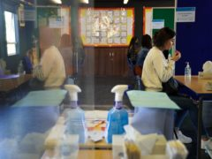 Pupils at Copthall School in Mill Hill, Barnet, are tested for Covid-19 ahead of their return to school (Kirsty O'Connor/PA)
