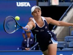 Ashleigh Barty hits a forehand during her victory over Clara Tauson (Elise Amendola/AP)