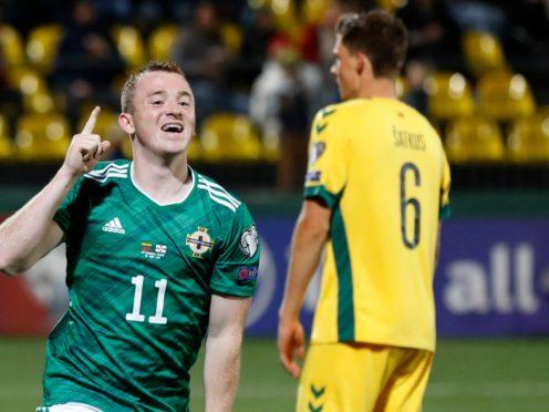 Shayne Lavery celebrates his goal in Lithuania (Mindaugas Kulbis/AP)
