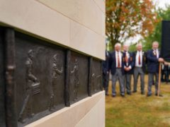 Members of the Lea Hall & Brereton Collieries Memorial Society observe the National Miners' Memorial (PA)