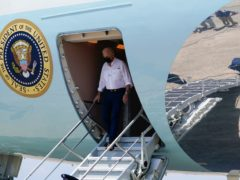 President Joe Biden steps from Air Force One as he arrives at Louis Armstrong New Orleans International Airport (Evan Vucci/AP)