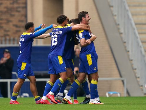 Will Nightingale will continue to play through the pain for AFC Wimbledon (Tess Derry/PA)
