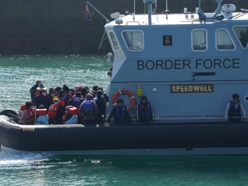 A group of people thought to be migrants are brought into Dover, Kent, by Border Force officers, following a small boat incident early this month (Jonathan Brady/PA)