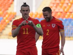 Gareth Bale (left) celebrates scoring in Wales' 3-2 World Cup qualifying victory over Belarus in Kazan (Alexei Nasyrov/AP)