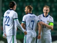 Shane Ferguson, right, struck the winner in Northern Ireland's victory over Estonia (Raul Mee/AP)