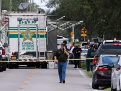 Police at the scene of the multiple in Lakeland (Michael Wilson/The Ledger via AP)