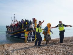 A group of people thought to be migrants are brought ashore from the local lifeboat at Dungeness in Kent, after being picked-up following a small boat incident in the Channel (Gareth Fuller/PA)
