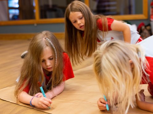 From left, Phoebe, 5, Martha, 6 and Tamsin, 6 from 22nd Walthamstow Rainbows take part in an activity to help build resilience and confidence, hosted by Girlguiding (David Parry/PA)