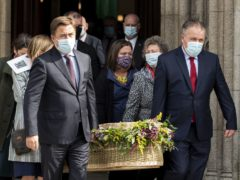 John Hume Jnr (left) and his brother Aidan (right) carry the coffin of their mother Pat Hume (Liam McBurney/PA)