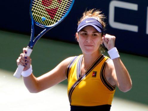 Belinda Bencic celebrates victory over Iga Swiatek (Elise Amendola/AP)