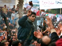 Zakaria Zubeidi pictured in 2004 being carried by supporters (AP Photo/Nasser Nasser, File)