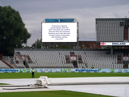 The big screen at an empty Emirates Old Trafford carries the news of the cancelled Test (Martin Rickett/PA)