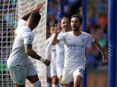 Bernardo Silva (right) struck in the second half as Manchester City beat Leicester (Nick Potts/PA)