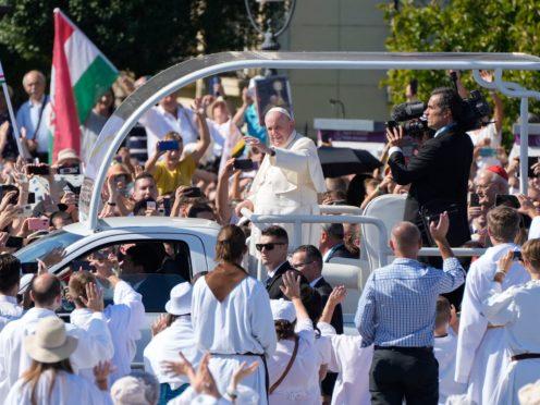 Pope Francis arrives on his popemobile to celebrate mass (Gregorio Borgia/AP)