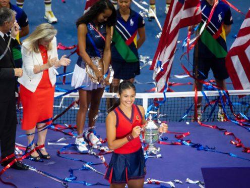 Emma Raducanu poses with the trophy (Michael Nagle/Xinhua via PA)