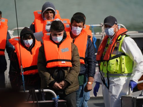 A group of people thought to be migrants are brought into Dover, Kent, by a Border Force patrol boat (PA)