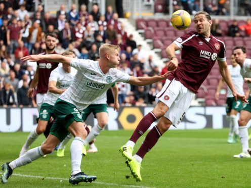 Peter Haring, right, in action against Hibernian (Jeff Holmes/PA)