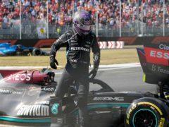 Lewis Hamilton walks away after the crash (Luca Bruno/AP)