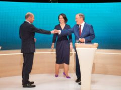Olaf Scholz, Annalena Baerbock and Armin Laschet (Pool/AP)