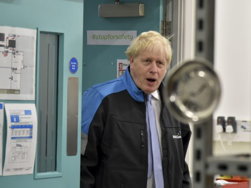 Prime Minister Boris Johnson said Covid measures would be kept in reserve (PA)