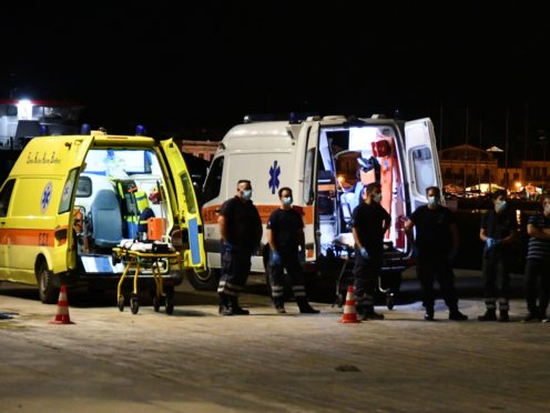 Emergency services attend after the crash (AP)