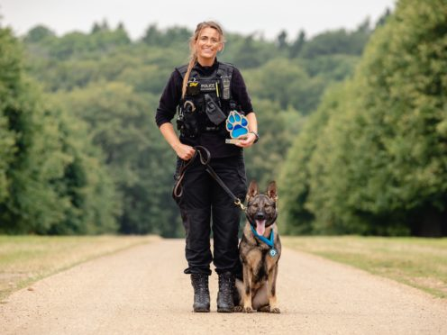 Police dog handler Pc Megan West and German shepherd Calli (Penny Bird/Thin Blue Paw Awards/PA)