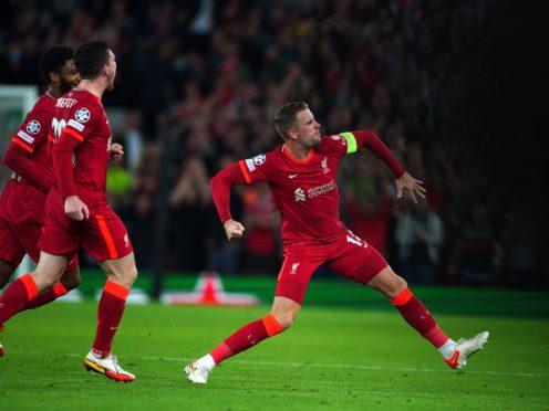Jordan Henderson (right) celebrates scoring Liverpool's winner (Peter Byrne/PA)