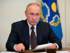 Vladimir Putin appeared via video-link for a meeting on Thursday (Alexei Druzhinin, Sputnik, Kremlin Pool Photo via AP)