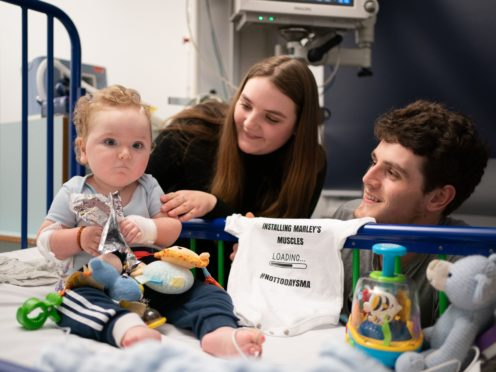 Rosie-Mae Walton and Wes Powell with their son Marley as he recovers at Sheffield Children's Hospital after receiving the ;most expensive drug in the world;, the genetic treatment Zolgensma (Joe Giddens/PA)