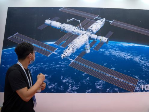 A mural showing an artist's impression of China's space station at the World Robot Conference in Beijing (Mark Schiefelbein/AP)