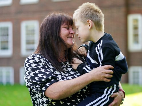 Rebecca Currie and her son Mathew can remain in their home after she won a court battle with the Environment Agency (Kirsty O'Connor/PA)